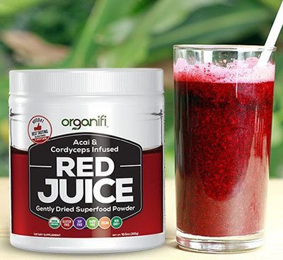 a glass of red juice powder