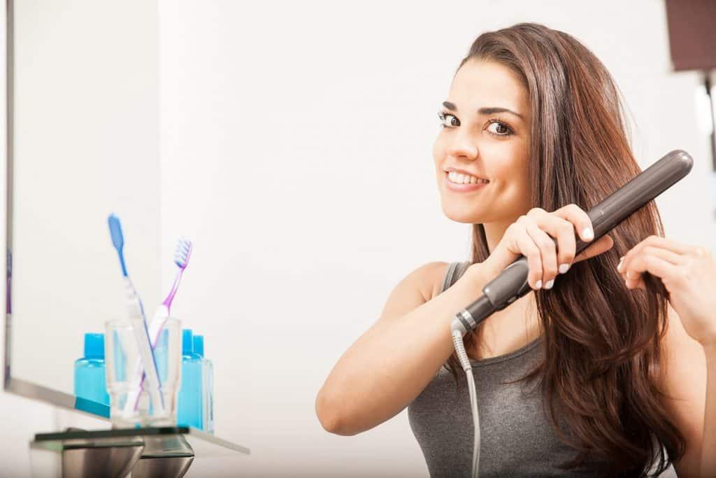 woman using a flat iron